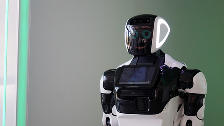 The latest generation robot with a monitor. Can recognize speech and answer questions