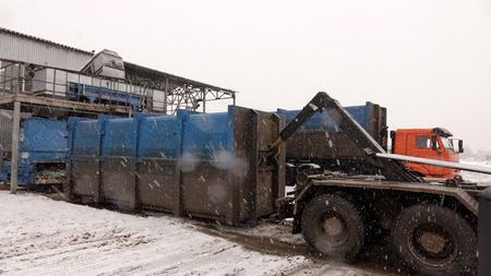 Loading the container with waste on a special machine .Recycling plant. Waste sorting and recycling business