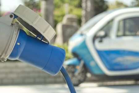 Charger for environmentally friendly car with electric motor. Electric mobility in the city