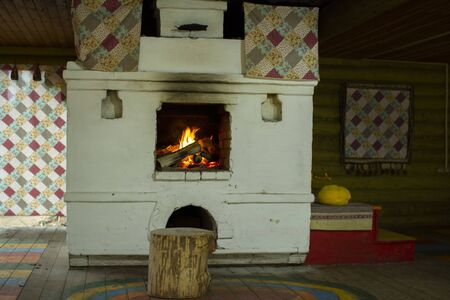 Traditional Russian oven, cooking on wood..