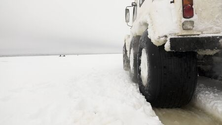 All-terrain vehicle for movement in hard-to-reach places. Car on the snow crust of the lake. Foto de archivo