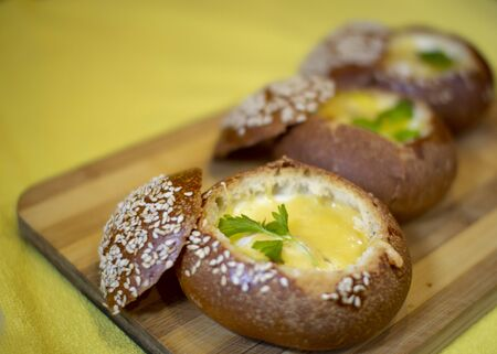 Buns with egg, bacon and melted cheese. Hot breakfast Banco de Imagens