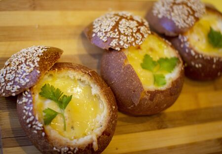 Buns with egg, bacon and melted cheese. Hot breakfast 写真素材