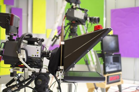 TV camera in the Studio. and professional high-definition video camera on a tripod