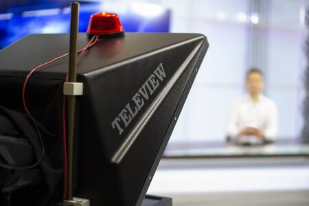 A male News anchor in a broadcast Studio reads text . Camera in the TV Studio. News anchor in a TV Studio . Stockfoto - 147984702