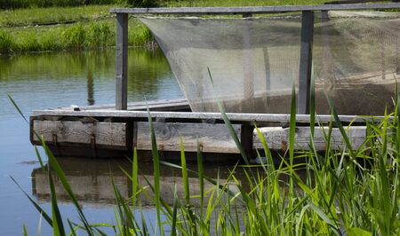 Fish farm in the pond. Aquaculture in the open air Stockfoto - 149851435