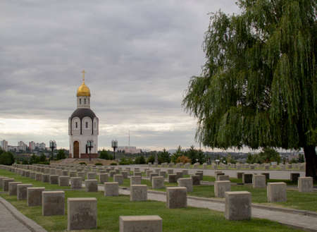 Christian chapel and tombstones at the Volgograd soldiers  memorial cemetery. Mamaev Kurgan, Volgograd, Russia-August 2020.