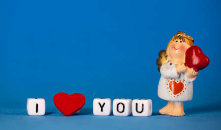 Cute angel and a declaration of love. Valentines Day. Postcard for the holidays.