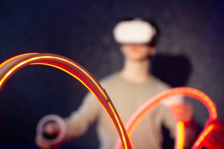 A teenager wearing virtual reality glasses .Technologies of the future. Zdjęcie Seryjne