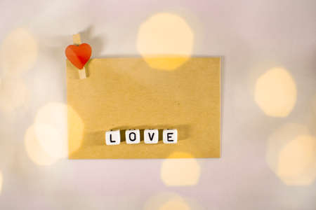 The word love consists of cubes with a space for the signature. Imagens