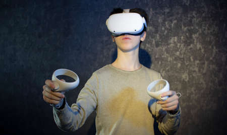 A teenager wearing virtual reality glasses .Technologies of the future. Zdjęcie Seryjne - 162588351