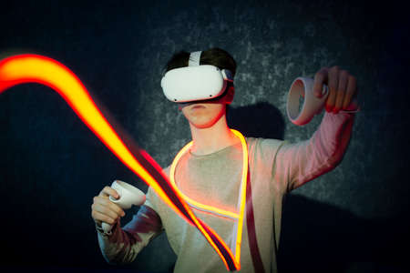A teenager wearing virtual reality glasses .Technologies of the future. Imagens