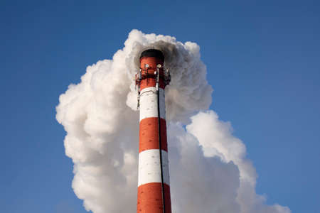 Smoke from the factory chimney. The concept of environmental protection
