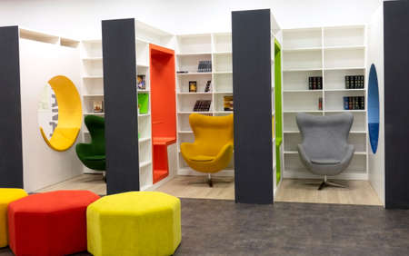 Bright designer chairs for relaxing and reading books. The concept of reading, education, and buying books. Vologda. Russia - March 2021.