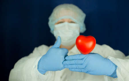 The heart is in the doctors hands. The concept of cardiology and healthcare.