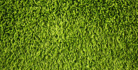 Green background made of artificial threads. Green fabric texture and pattern for background. Zdjęcie Seryjne