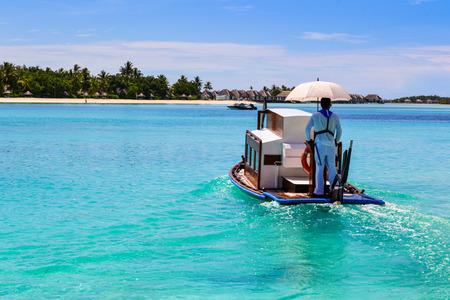 lagoon: Maldivian boat on blue lagoon