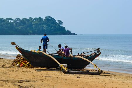 incredible: Incredible India. fishers on the beach with boat Editorial