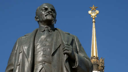 Lenin monument is on background of main pavilion of VDNKh, Moscow, close-up
