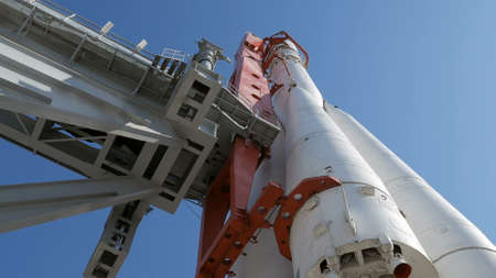 Rocket on launch pad in sunny day tilt up 스톡 콘텐츠