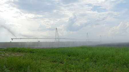 a fog by irrigation system in cloudy day Banco de Imagens