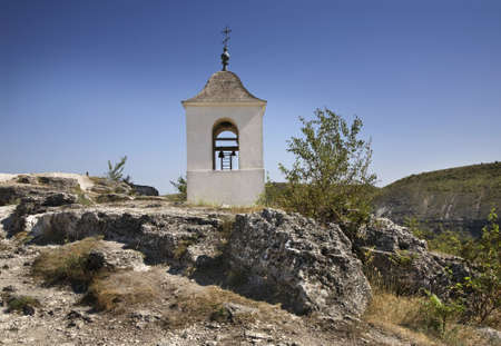 Belfry of rock monastery in Old Orhei. Moldova photo