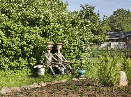 statuary garden: Wooden human figures in Prazaroki. Belarus Stock Photo