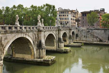 embankment: Bridge of Sant Angelo in Rome. Italy Stock Photo