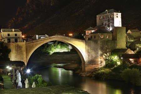 former: Old bridge in Mostar at night. Bosnia and Herzegovina
