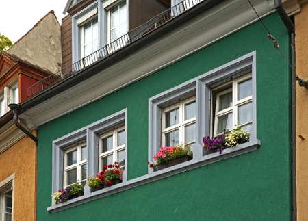 windows: Fragment of old building in Freiburg im Breisgau. Germany Stock Photo