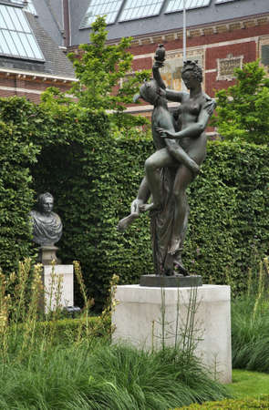 Sculpture of Mercury and Psyche at park of Rijksmuseum - Dutch national museum in Amsterdam. Netherlands