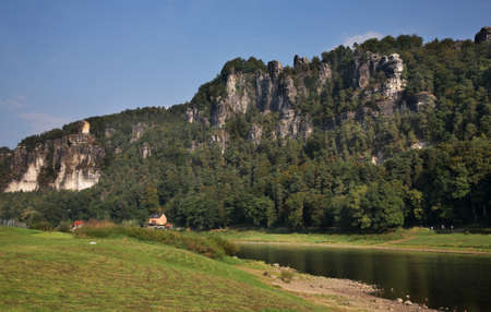 Elbe river and Bastei at Elbe sandstone mountains near Rathen village. Saxon Switzerland National Park. Germany Stock Photo