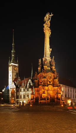 Holy Trinity column and townhouse at Upper Square (Horni namesti) in Olomouc. Moravia. Czech Republic Stock Photo
