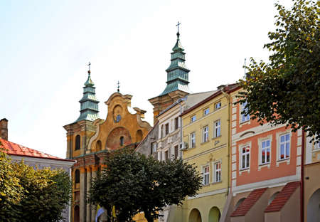 Market Square and church of St. Mary Magdalene with Franciscan cloister in Przemysl. Poland Stock Photo