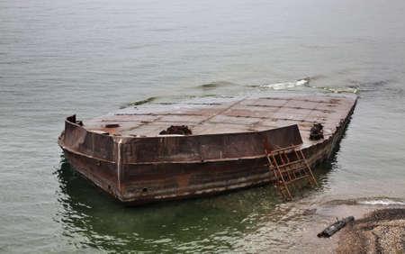 Submerged ship in Port-Baikal settlement. Irkutsk oblast. Russian 版權商用圖片