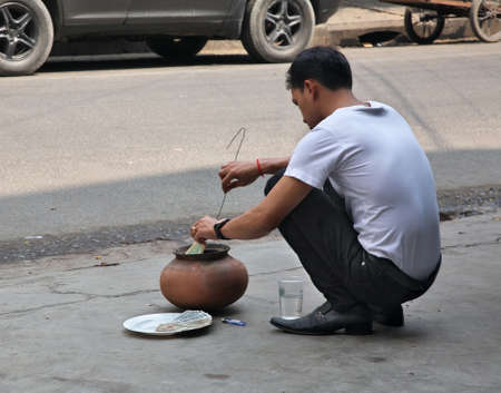 Traditional burning of counterfeit dollars in Phnom Penh street. Cambodia
