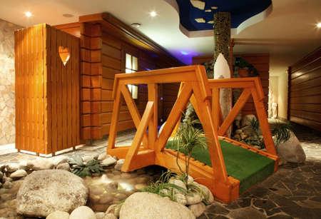 Wooden bridge at Wellness and spa of thermal park Besenova at Ruzomberok district. Zilina region. Slovakia Editorial