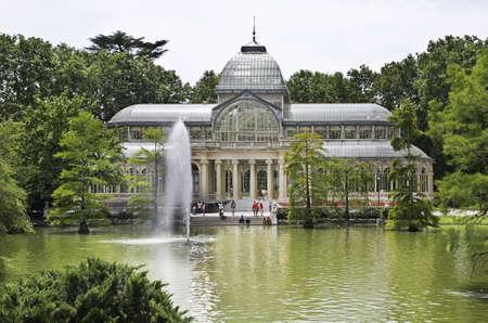 Crystal Palace (Palacio de Cristal) at Buen Retiro park (Park of Pleasant Retreat) in Madrid. Spain Editorial