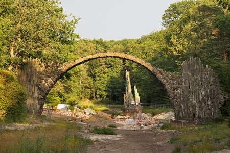 Bridge of Devil (Rakotzbrucke) over Rakotzsee lake at Park Kromlau near Gablenz. Germany