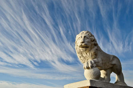 might: Lion sculpture with the blue sky Stock Photo