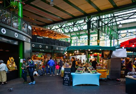 London / United Kingdom - September 26, 2019: stalls with street food on the famous Borough Market. Located in Southwark, close to London Bridge, this lively market is a popular tourist attraction
