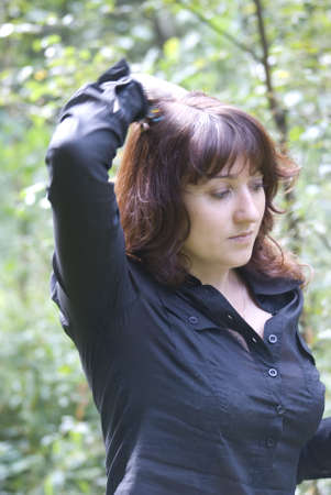 Young woman upping her hair photo
