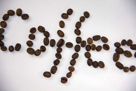 Coffee beans sign made from small same bean photo
