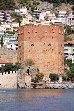 Red brick tower in Alanya photo