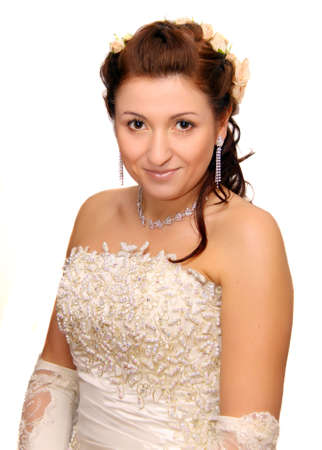 sitting beauty bride in white dress photo