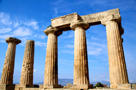 ruins is ancient: apollon temple in corinth Greece Stock Photo