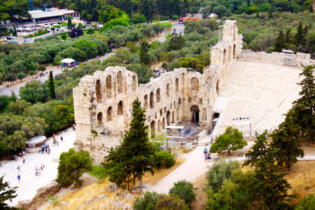 ncient theatre of Herodes Atticus is a small building of ancient Greece used for public performances of music and poetry, below on the Acropolis and in background dwelling of metropolis Athens photo