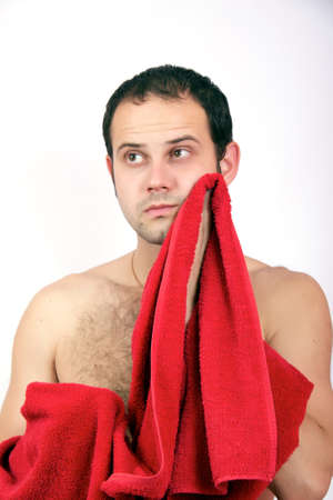 Beautiful muscular man with the towel on the white background Stock Photo - 8313931