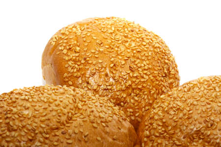 Loaf of bread and rolls isolated on the white photo