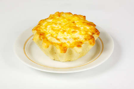 ndividual meat pie with potato topping on the white photo